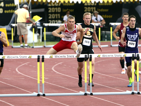 Colin Reichenberger, shown here in the 2014 State Track and Field Championships, is at it again, breaking records. He broke the 300 meter record at Belle Plaine Tuesday.