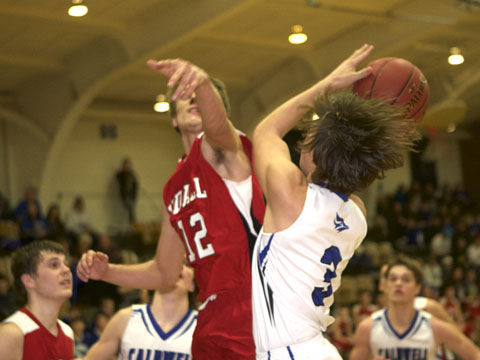 Caldwell Kyler Bruey with the shot in battle against Udall. Sam Wencel shooting in picture above.