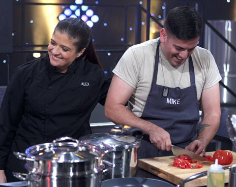 Participant cook Mike Castaneda cooks during the first cooking challenge while chef Alex Guarnaschelli mentors, as seen on Food Network's All-Star Academy, Season 1. (Food Network photo)