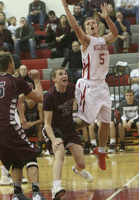 Connor Phelps helps keep Wellington close in first half.