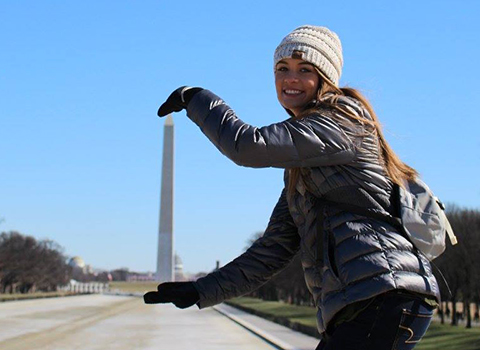 WHS Senior Madi Adams holds the Washington Monument in her hands as group of students take the Mike Wilmoth history trip to Washington D.C.