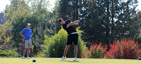 Brian Peck swings the golf club at the KCAC Tournament in Garden City.