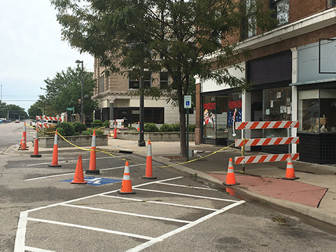 "More cones and barricades surrounds the building known as ""Lincoln Place"" this week."