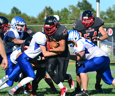 A&A's Seth Hemberger gets wrapped up by Caldwell defense.