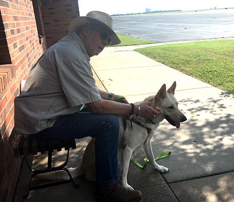 Ivory, the white German Shepherd dog, with Humane Society member Kim Woodrow.