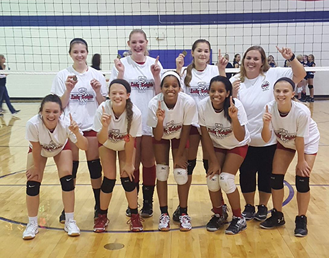Wellington Eighth Grade volleyball team becomes Pioneer League Champions.