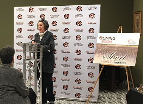 Marjorie Short addressing the crowd after announcing the donation of 18-acres of land to Cowley College.